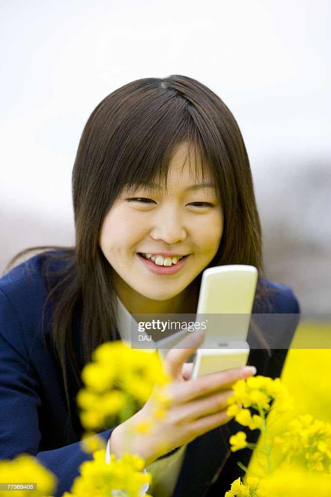 High School Student Taking Picture with Mobile Phone, Differential Focus : Photo
