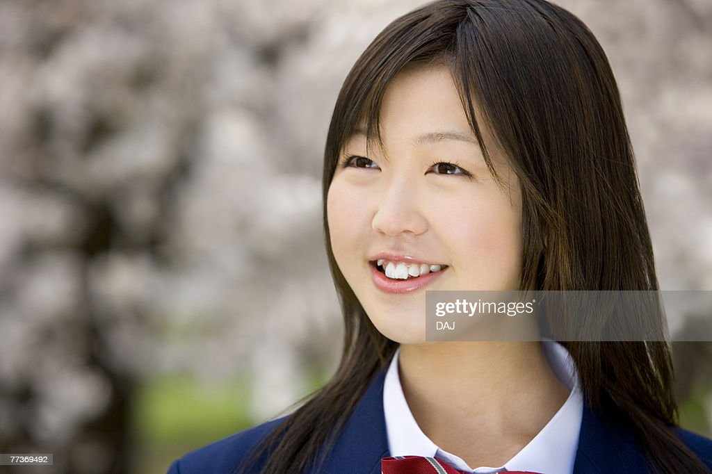 High school student under the cherry blossoms, differential focus : Stock Photo