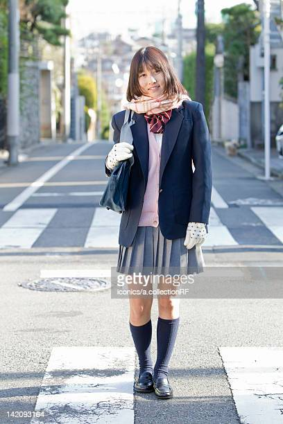 High School Student Walking on Street