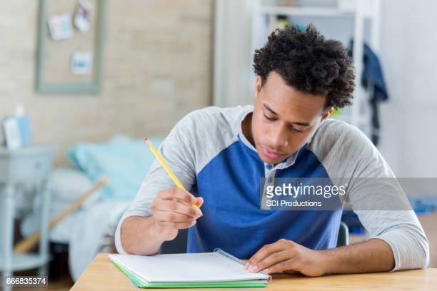 high school student working on homework - handsome black boy stock photos and pictures