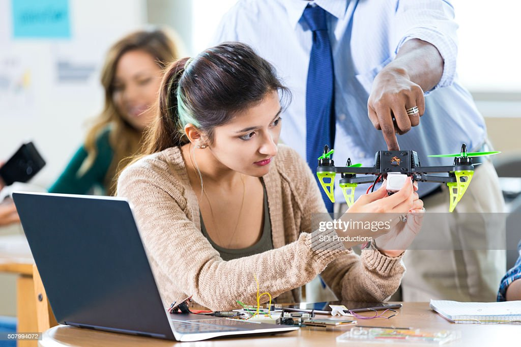 STEM high school student works on drone in class : Stock Photo