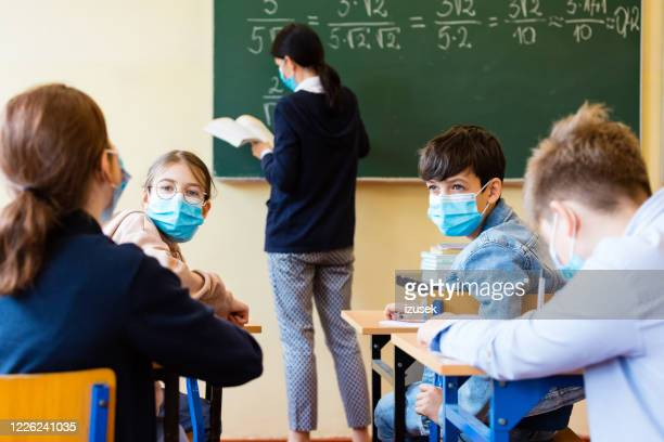 high school students at a maths lesson during covid-19 - education stock pictures, royalty-free photos & images