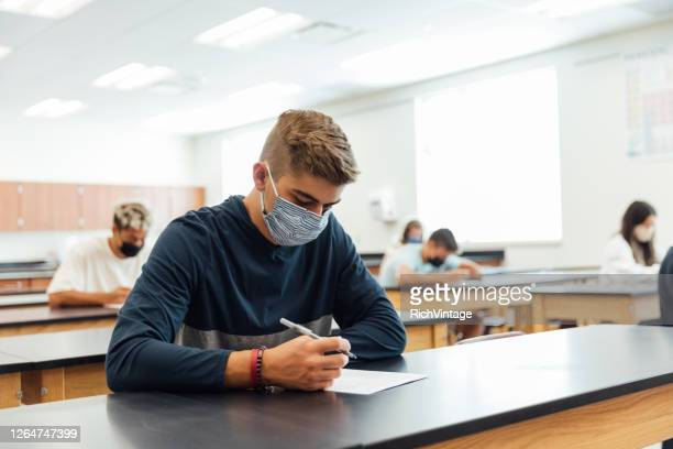 high school students at school during covid-19 - secondary school stock pictures, royalty-free photos & images