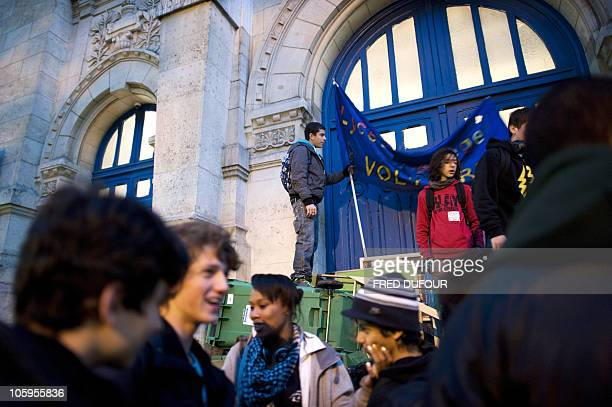High school students block the entrance of the Lycee Voltaire high school on October 18 2010 in Paris to protest against pension reform French riot...