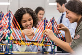 High school students build bridge replica in engineering class