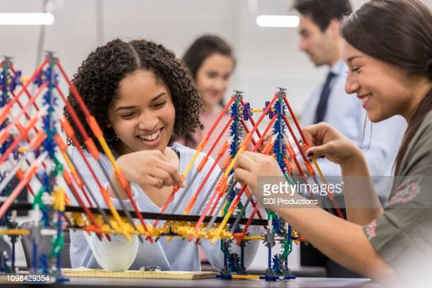 high school students build bridge replica in engineering class - bridge built structure stock pictures, royalty-free photos & images