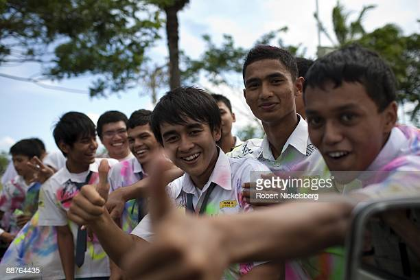 High school students celebrate their last day of school in the downtown area of Aceh province's capital city June 15 2009 Following the devastating...