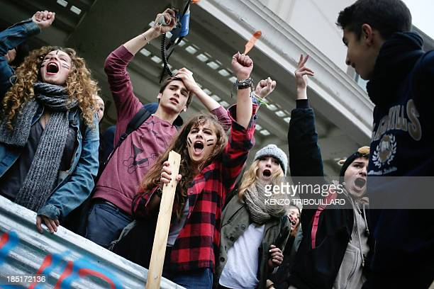 High school students demonstrate as they conduct a blockade of their school in Paris on October 18 in protest against the deportation of foreign...