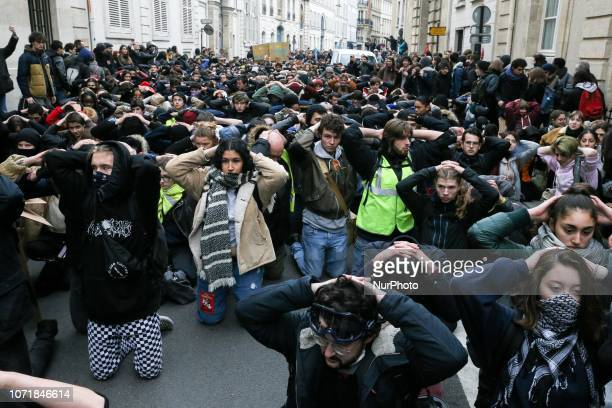 High school students demonstrate on their knees on December 11 2018 in Paris France to protest against the different education reforms including the...