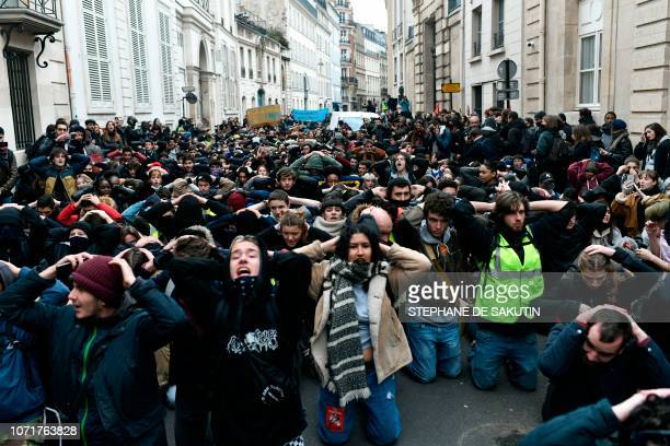 High school students demonstrate on their knees on December 11 in Paris France to protest against the different education reforms including the...