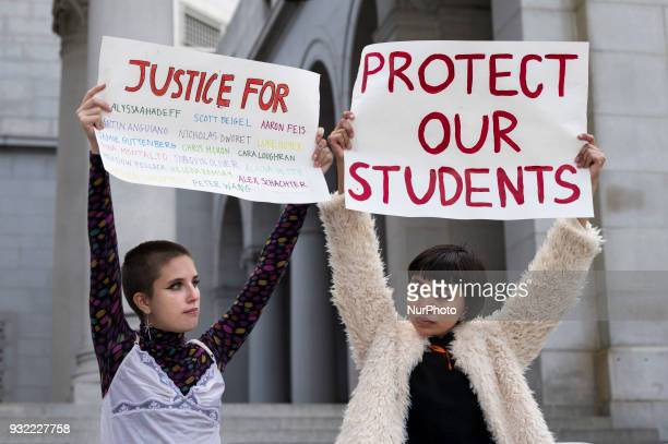 High school students Emily Rossdanson and Sofia Ramirez participate in a protest against gun violence Los Angeles California on March 14 2018...