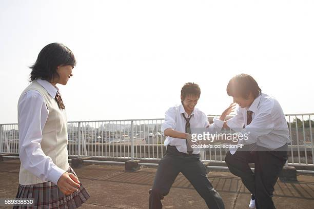 High school students fighting on rooftop, Japan