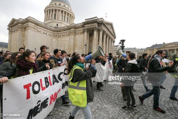 High school students hold banners in front of the Panthéon on December 11 as they take part in a demonstration in Paris France to protest against the...