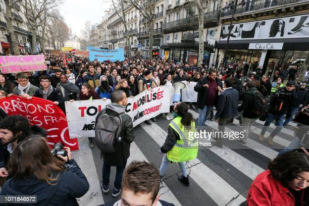 High school students hold banners on December 11 as they take part in a demonstration in Paris France to protest against the different education...