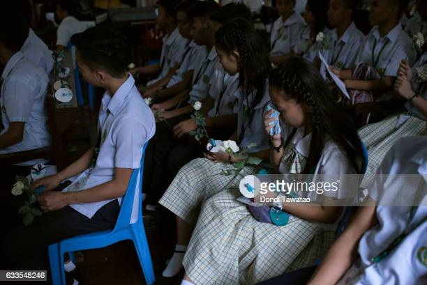 High school students hold flowers and candles during a mass held for victims of the drug war on February 2 2017 in Manila Philippines Philippine...