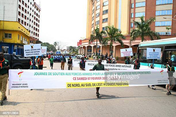 High school students hold placards as they take part in a demonstration on February 7 2015 in Douala supporting the Cameroonian army engaged in a...