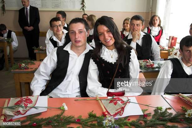 High school students in Hungarian national costume in classroom Gheorgheni Transylvania Romania