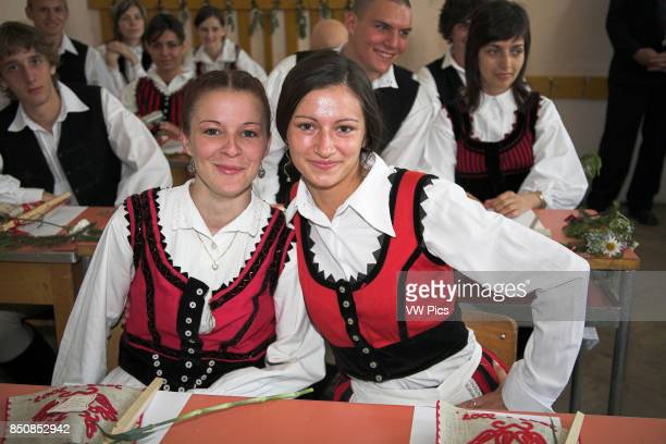 High school students in Hungarian national costume in classroom Gheorgheni Transylvania Romania