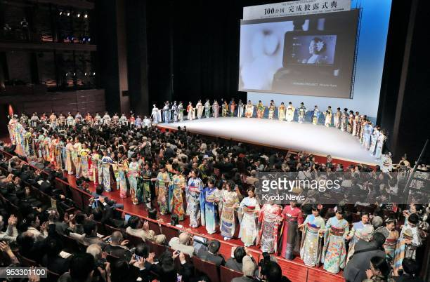 High school students in kimono bearing designs representing 100 of the 196 countries expected to join the 2020 Tokyo Olympics and Paralympics join...