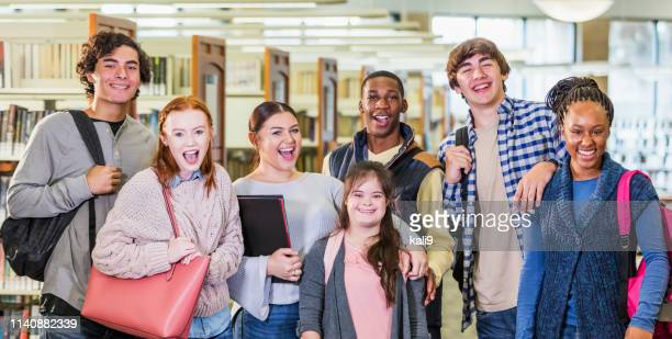 high school students in library, girl with down syndrome - teenagers only stock pictures, royalty-free photos & images