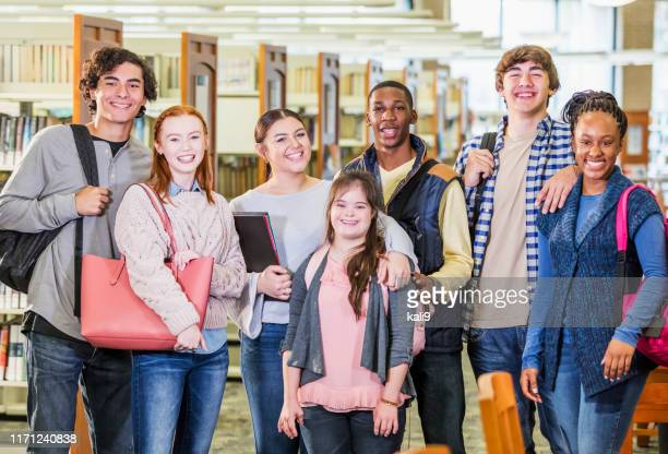 high school students in library, girl with down syndrome - learning disability stock pictures, royalty-free photos & images