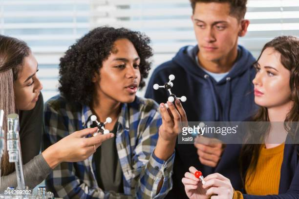 high school students in science lab with molecule models - teenagers only stock pictures, royalty-free photos & images