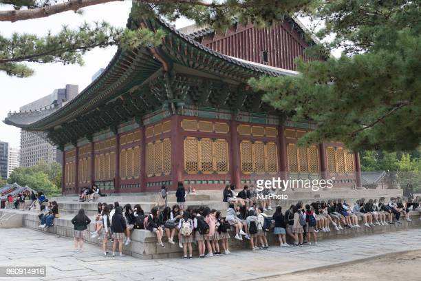 High school students in Seoul the capital city of South Korea taking a break while visiting Deoksugung Palace in the city center Despite recent...