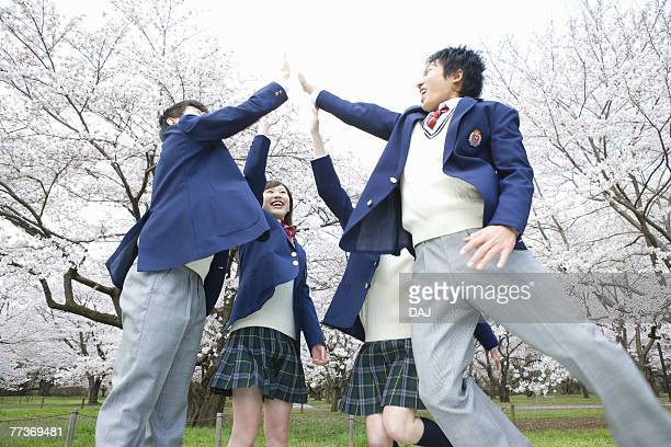 High School Students Jumping and Giving Each Other High-five
