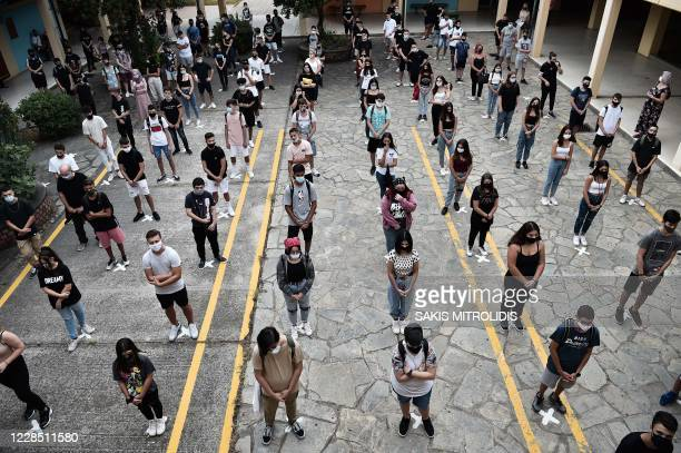 High school students keep a social distances in the school yard school on the first day of classes of the new academic year during the ongoing novel...