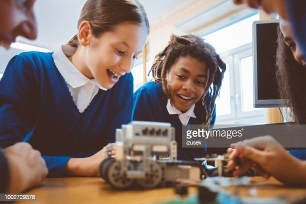 high school students learning robotics - uniform stock pictures, royalty-free photos & images