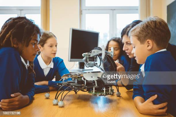 high school students learning robotics - stem stock pictures, royalty-free photos & images