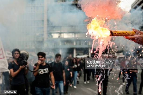 TOPSHOT High school students light flares while demonstrating in central Athens on November 4 against the shortage of teachers in schools and the...