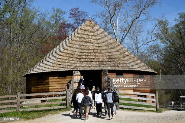 High school students on a field trip enter a recreation of a 16sided barn at Mount Vernon the plantation owned by George Washington the first...