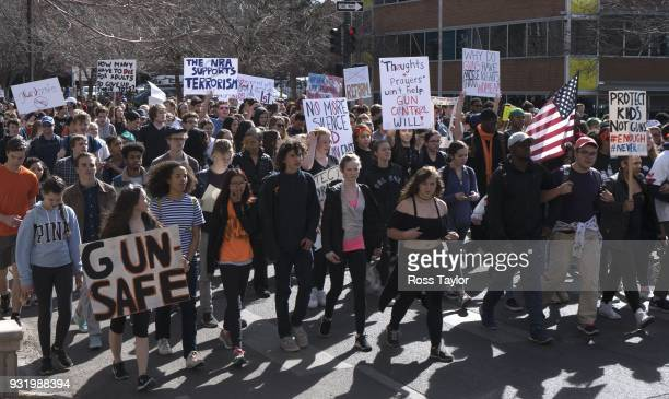 High school students protest against gun violence by marching towards the Colorado State Capitol grounds on March 14 2018 in Denver Colorado It was...