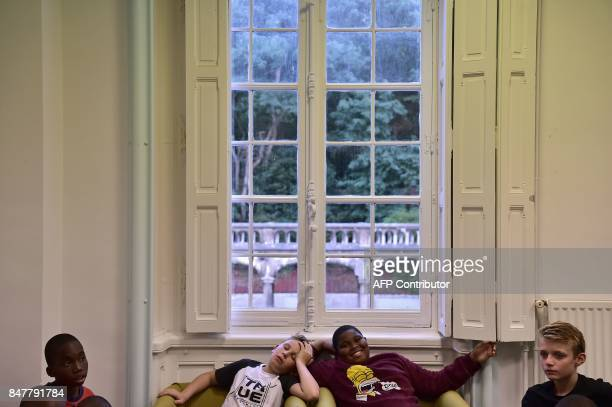 High school students relax at the common room at the end of a school day at the boarding school at the Apprentis d'Auteuilmanaged SaintPhilippe...