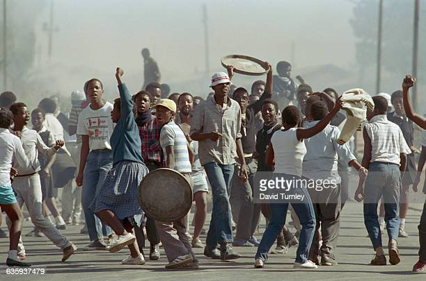 High school students riot in a Soweto street near Winnie Mandela's house protesting apartheid