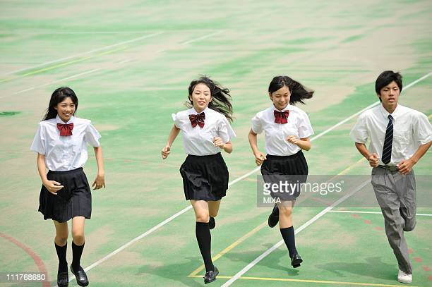 high school students running in the schoolyard - female high school student stock photos and pictures