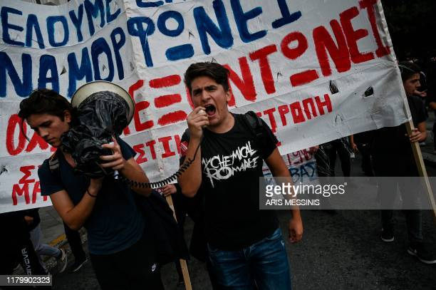 High school students shout slogans while demonstrating in central Athens on November 4 against the shortage of teachers in schools and the upcoming...