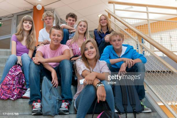 high school students sitting on staircase