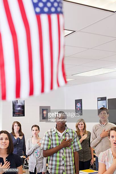 High school students swearing allegiance to the American flag