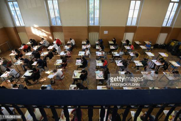 High school students take the philosophy exam the first test session of the 2019 baccalaureate on June 17 2019 at the Pasteur high school in...