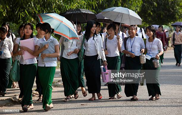 High school students walk home after school December 13 2011 in Yangon Myanmar The education system is based on the United Kingdom's system after...