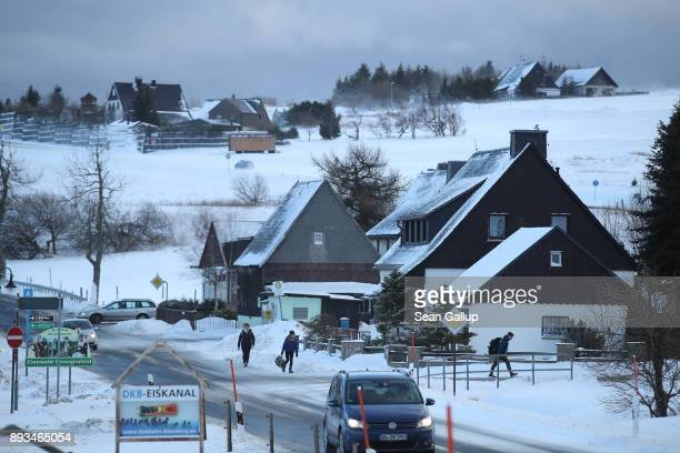 High school students walk home after school on a bitter snowswept day on December 14 2017 in the former mining town of Zinnwald near Altenberg...