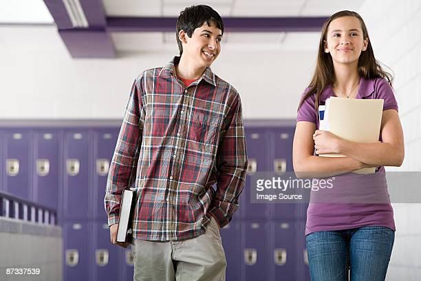 High school students walking down a corridor