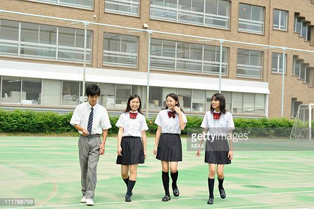 High School Students Walking on the Schoolyard