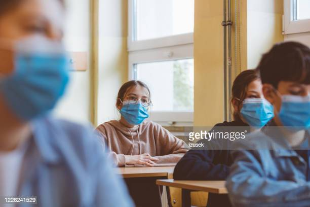 high school students wearing n95 face mask at school - classroom stock pictures, royalty-free photos & images