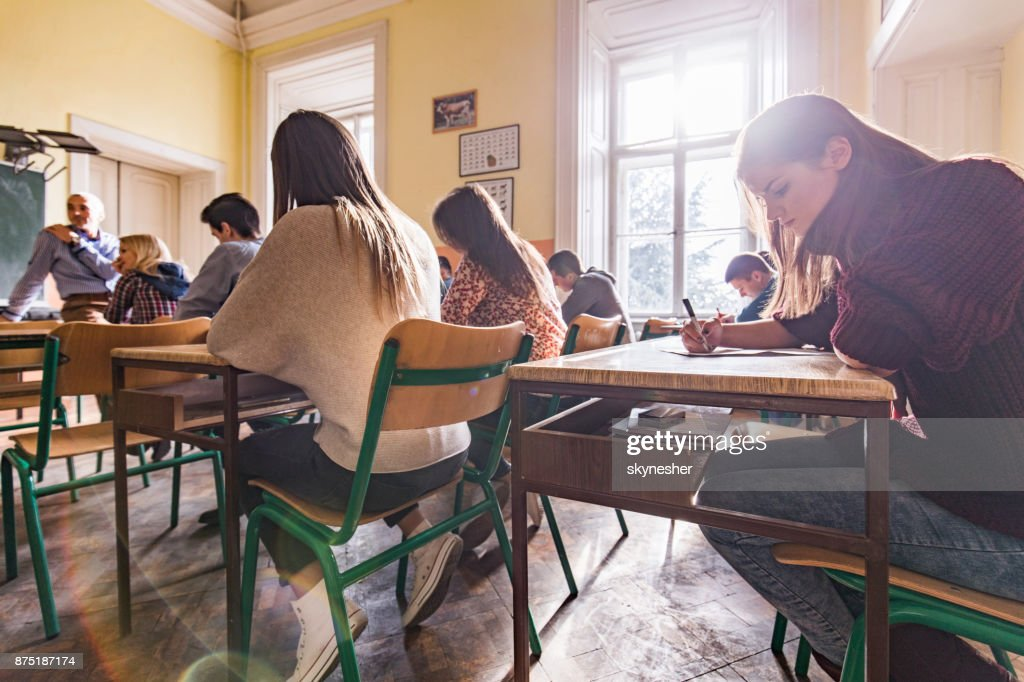 High school students writing a test in the classroom. : Stock Photo