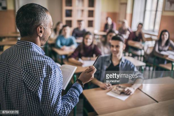 High school teacher giving a lecture in the classroom.