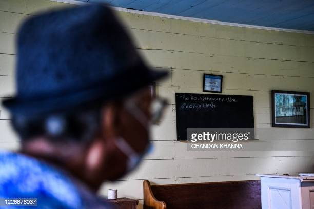 High school teacher Joeretha Stringer stands inside an old school turned museum of African American Culture in Fayette, Jefferson County, Mississippi...