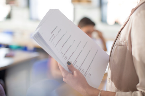 High school teacher with test notes in classroom - gettyimageskorea
